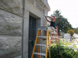 Rusty Joiner removes mortar from the Morris-Hirsch Mausoleum.  Credit: David Pendered
