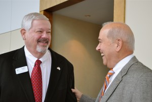 Former Gwinnett County Commissioner Mike Berg (left), who now chairs the Dawson County Board of Commissioners, catches up with former Gwinnett County commission Chairman Wayne Hill. Credit: Donita Pendered