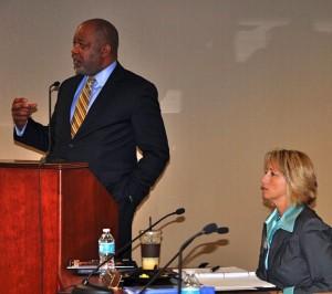Doug Hooker, ARC's executive director, explains his agency's reorganization as GRTA Executive Director Jannine Miller observes. Credit: Donita Pendered