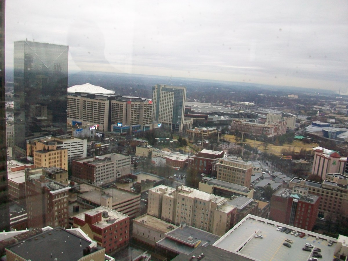 qInvest Atlanta's new offices overlook the Georgia Dome, Centennial Olympic Park, to the west.