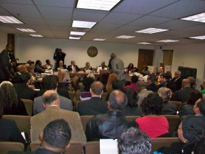 Joe Beasley, a longtime civil rights advocate, admonishes the Fulton County delegation over various proposals, as Rep. Lynne Riley gavels him out of order. Credit: David Pendered