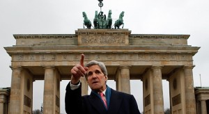John Kerry's move to secretary of state distances him from efforts to create a national infrastructure bank. Here, Kerry stands before the Brandenburg Gate, in Berlin. Credit: Reuters/Fabrizio Bensch