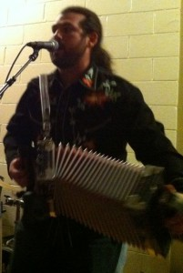 Dennis Stroughmatt, lead performer for Creole Stomp, a band from Illinois.