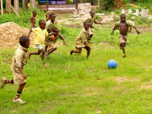 in Hohoe, Ghana, young boys chase the One World Futbol.