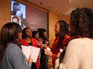 Natasha Daniels, second from right, with Georgia State University students at a recent event about African-American women and the way they wear their hair at work. Daniels is a legislative analyst for the city of Atlanta who advised them that natural hair can be part of a polished appearance. (Credit GSU)