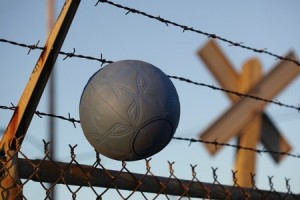 One World Futbol and barbed wire (Credit: Rory Earnshaw)