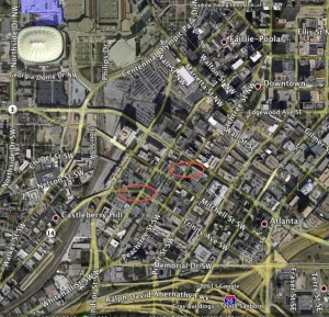 Atlanta police raided buildings south of Five Points in the areas identified by the red ovals. Credit: Google Earth, David Pendered