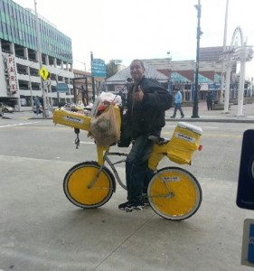 A vendor on a bicycle sells his wares at MARTA's Five Points Station. Credit: atlsoma.com