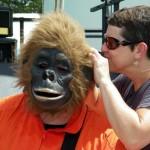 Photo of Suellen Germani adjusting Jamie Galatas' gorilla mask at Drive Invasion 2012.