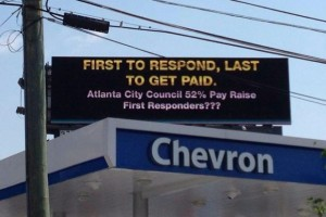 This billboard that calls for pay hikes for public safety employees has been raised over Atlanta. Credit: AFR Report