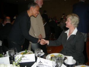 Atlanta's Lisa Borders greets Houston Mayor Annise Parker during the first night of LINK trip (Photo by Maria Saporta)