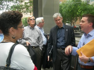 Preservation Houston's Jim Parsons (right) gives Atlanta group a downtown walking tour. GSU President Mark Becker (center) listens attentively (Photo: Maria Saporta)