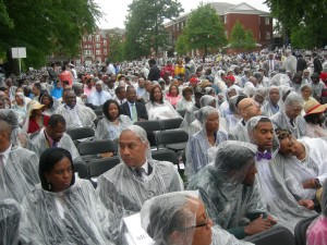 Century Campus lawn is filled with people in ponchos waiting for ceremony to begin