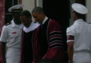 Morehouse President John Wilson escorts President Barack Obama to stage