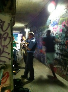 Photo of a runner passing by the Sacre du Krog performance in the Krog Street tunnel.