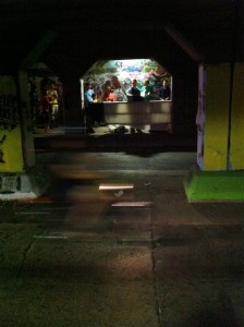 Photo of motorcyclist zipping by the Sacre du Krog performance in the Krog Tunnel.