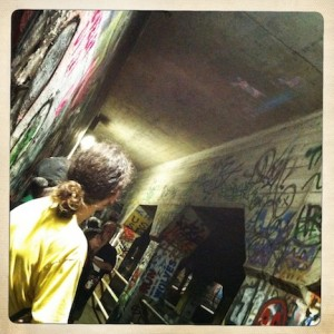 Photo of the audience at Sacre du Krog watching videos projected on the ceiling of the Krog Street tunnel.
