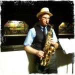 Photo of Brian Bannon playing sax in the Krog Street Tunnel during the Sacre du Krog.