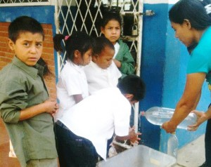 An alumna of GSU's Institute of Public Health, Christy Kill, now works with a program in Nicaragua that is seeking to improve the quality of life of infants and young children. Here, youngsters are taught how to cleanse their hands. Credit: GSU