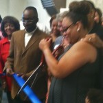 Photo of Brandy Brown-Rhodes cutting the ribbon dedicating the Derwin Brown Police Precinct on June 28.
