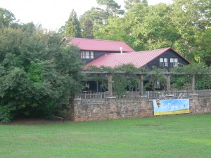 """The Inn at Serenbe with """"RayDay"""" banner (Photo by Maria Saporta)"""