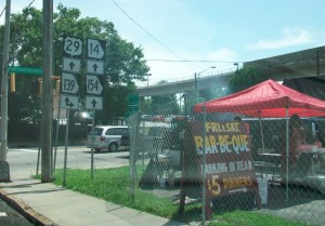 Entrepreneurs, such as the owners of this BBQ stand, have found a way to function despite the confusion of roads that could be reduced if Northside Drive were rerouted on the northern portion of West End, according to a report from Georgia Tech. Credit: David Pendered