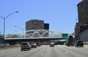 A proposed structure atop the Peachtree Bridge, across the northbound lanes of the Downtown Connector, intends to beautify the entrance into the city.
