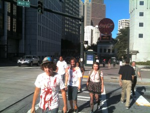 Extra in a zombie series filmed in the Fairlie-Poplar district of downtown Atlanta go home after work in October 2011. Credit: David Pendered