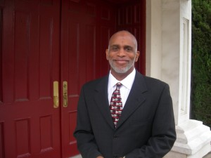 Lloyd Hawk, chairman of Friendship's board of trustees, at the front door of the church Sunday