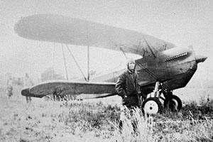 Charles Lindbergh stands beside an airplane on Sapelo Island, around 1929.