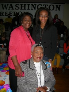 Angela Watkins stands next to her daughter, Farris Christine Watkins, with their aunt and great aunt Naomi King, widow of A.D. King, seated