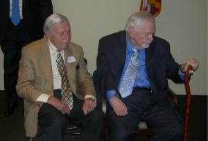 Former Gov. Carl Sanders sits next to Bill Shipp
