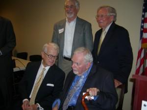 Bill Shipp visits with Robert Coram (seated), Lee Walburn and Jim Minter