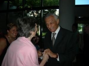Ann Cramer congratulates C.T. Vivian