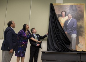 At the moment of the portrait unveiling, Andrew and Carolyn Young with the painter — Ross Rossin (Special - GSU and Andrew Young Foundation)
