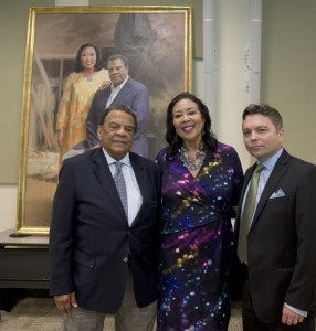 Andrew and Carolyn Young stand next to painter Ross Rossin in front of the portrait he painted in their honor (Special - GSU School of Public Policy and Andrew Young Foundation)