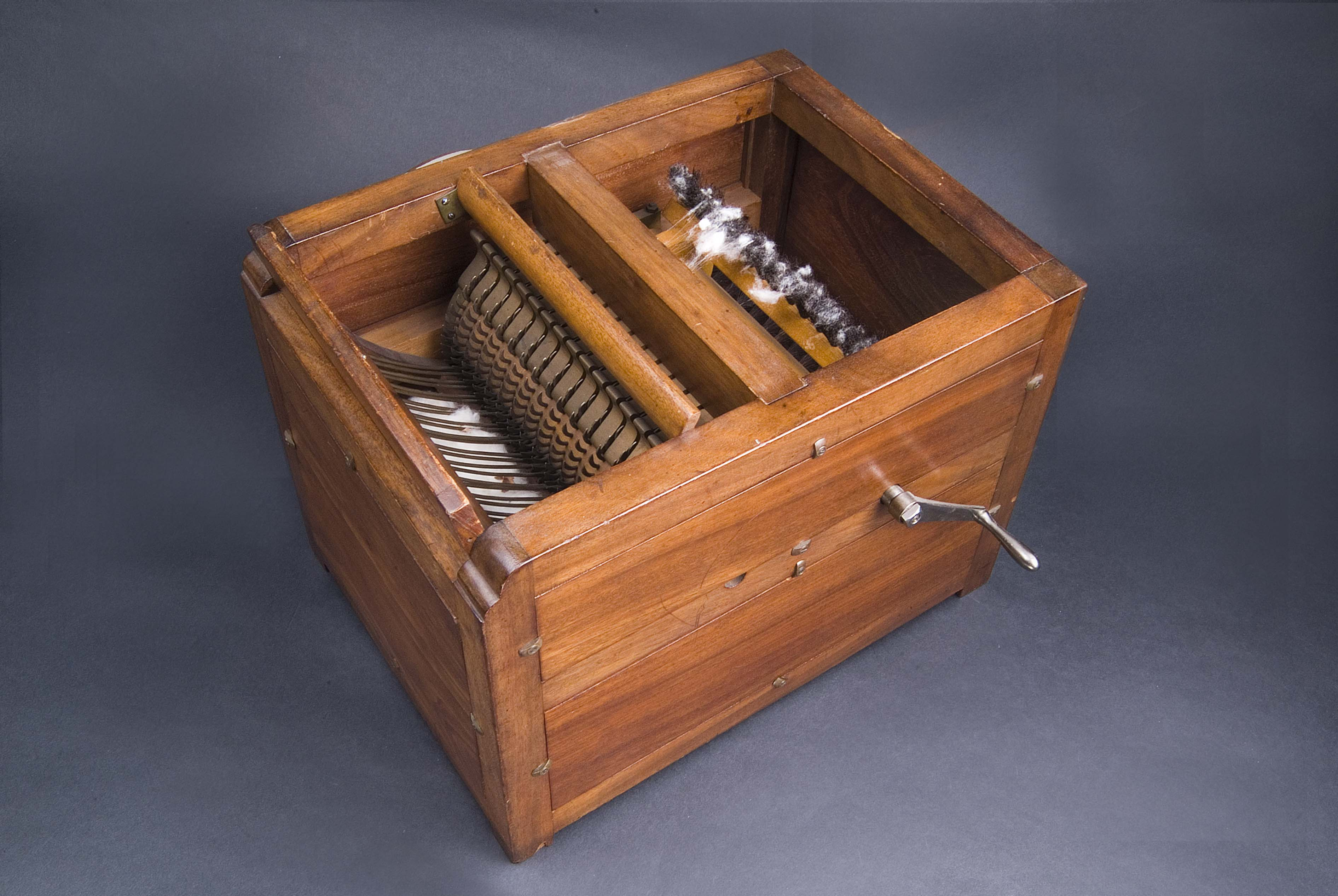 Eli Whitney's cotton gin mechanized the removal of seeds from cotton fibers.