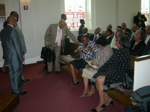Members of Friendship's congregation gather after vote (Photos by Maria Saporta)