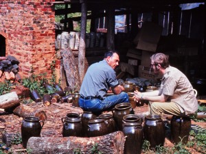Folklorist John Burrison (right) with potter Lanier Meaders in 1970, demonstrating another use for churns. Photo by Dick Pillsbury