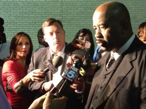 Rev. Rodney Turner talks to reporters after the vote