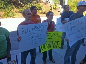 """Photo of students at Candler School of Theology and supporters recently protesting the seminary giving a significant award to an internationally-known alumnus, Rev. H. Eddie Fox. Fox was honored for his support for Candler and global work, but protesters pushed back because in 2008 he helped preserve church language that homosexuality is """"incompatible with Christian teaching."""""""