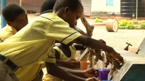 School children drinking water from a Slingshot purification system pilot site outside Accra, Ghana (Photo: Coca-Cola Co.)