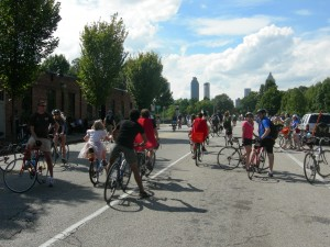 Cyclists head towards Boulevard with downtown skyline in background