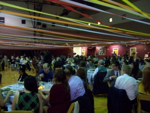 Photo of alumni and supporters of the student newspaper and website program who packed the King Center for VOX's 20th anniversary homecoming.
