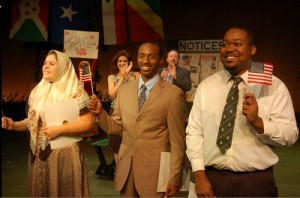 Photo of Asad (center, played by Eric J. Little) attends citizenship ceremony, flanked by Andra Ward and Sam Higgins-King, who are also being sworn in as new Americans. Credit: Third Country, 2013, Horizon Theatre Company.