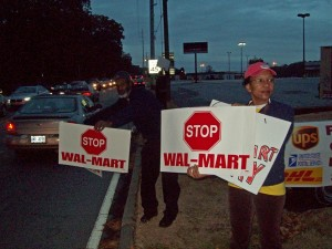 Photo of Grace Campbell, a protester with Good Growth DeKalb, opposing Walmart expanding into Suburban Plaza in Decatur.