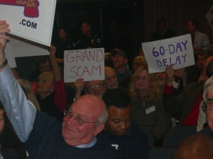 Opponents to the stadium MOU vote Tuesday night show their hand-painted signs