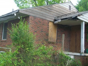 Vacant and boarded up housing, such as this one near Washington Park, is a sign of blight that's related to intergenerational poverty. Credit: David Pendered