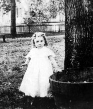 """Lumpkin at age two in Gainesville. She grew up hearing tales of the """"old times"""" before the Civil War, and was surrounded by proponents of Lost Cause mythology. Yet she was haunted by the memory of a violent episode she witnessed as a child. Later, she challenged the beliefs of her family and society."""