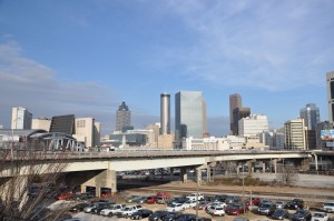 Looking north, the Atlanta skyline rises behind the Martin Luther King Jr. Drive viaduct above the gulch, where a $1.1 billion mixed use development is planned. Credit: Donita Pendered